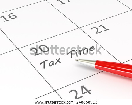 Tax Time words  on a calendar  - stock photo