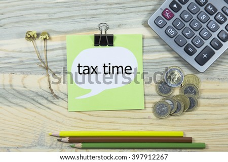tax time writing in sticky note. pen,euro and calculator. business concept - stock photo