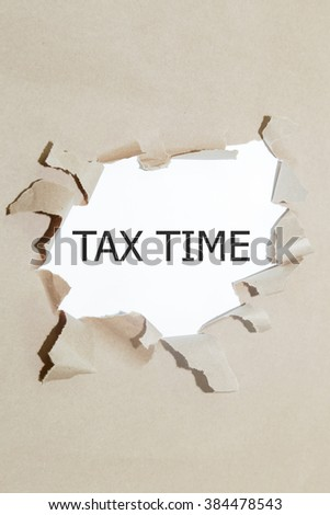 Tax Time written under torn paper. - stock photo