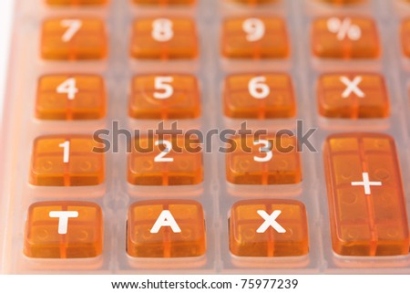 Taxation concept - Orange calculator with the word TAX added across the bottom - stock photo
