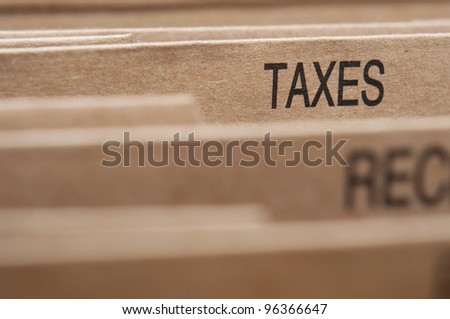 Taxation section tab in folding file. - stock photo