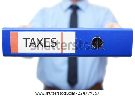 Taxes word is written on the binder - stock photo