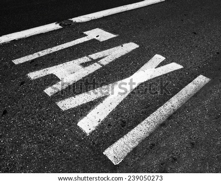 Taxi bus lane in Madrid, Spain - stock photo