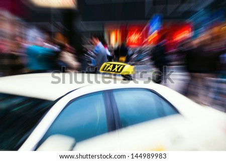 taxi in the city with creative zoom effect - stock photo