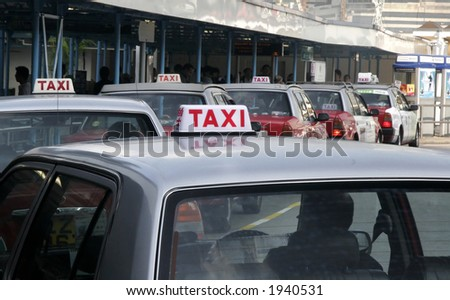 Taxi line in Hong Kong - stock photo