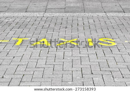 Taxi parking marked on a street in the UK - stock photo