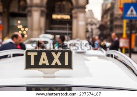 taxi stand in Milan, Italy - stock photo