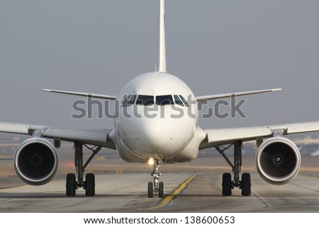 Taxiing plane - stock photo