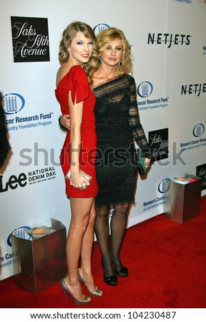 "Taylor Swift and Faith Hill at the EIF's Women's Cancer Research Fund's ""An Unforgettable Evening"" Benefit, Beverly Wilshire Four Seasons Hotel, Beverly Hills, CA. 01-27-10 - stock photo"