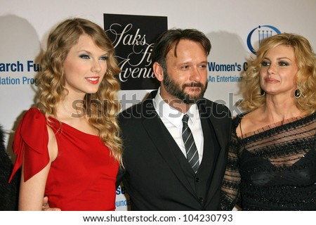 "Taylor Swift, Tim McGraw and Faith Hill at the EIF's Women's Cancer Research Fund's ""An Unforgettable Evening"" Benefit, Beverly Wilshire Four Seasons Hotel, Beverly Hills, CA. 01-27-10 - stock photo"