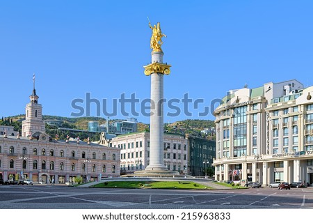 TBILISI, GEORGIA - AUGUST 16, 2014: Freedom Square with Freedom Monument depicting St George slaying the dragon, The monument by Georgian sculptor Zurab Tsereteli was unveiled on November 23, 2006. - stock photo