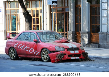 TBILISI, GEORGIA - JUNE 15, 2015: Lukoil car in the street of the city removed from the mud and sludge after it had been washed away during the tragic flood - stock photo
