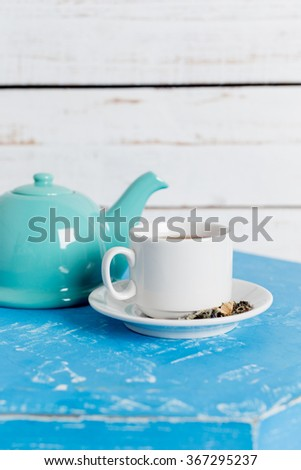 Tea accessories on pastel wooden background - stock photo