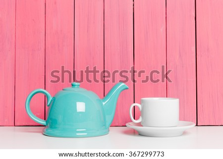 Tea accessories on pink wooden background - stock photo