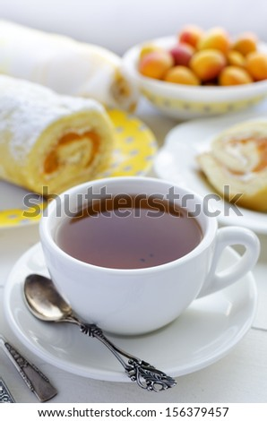 Tea and apricot roll - stock photo