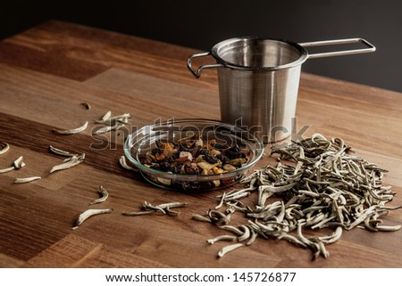 tea and tea strainer - stock photo