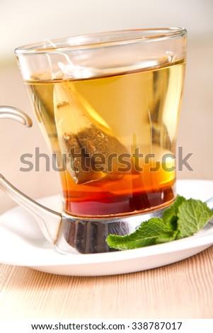 Tea bag in a transparent glass - stock photo