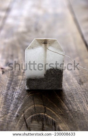 Tea Bag on old wooden table, close up - stock photo