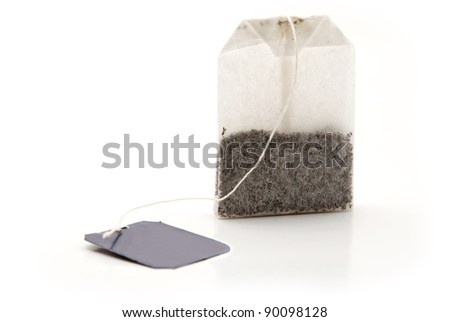 tea bag with a label on a white background - stock photo