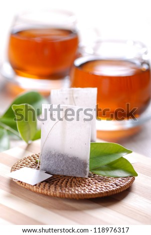 tea bags with cups in the background - stock photo
