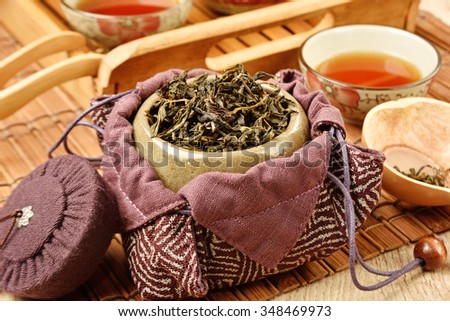 Tea caddy and Chinese tea set on wooden table - stock photo