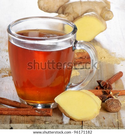 Tea cup and spices - stock photo