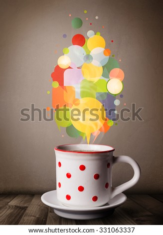 Tea cup with colorful speech bubbles, close up - stock photo
