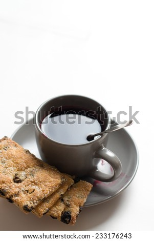 Tea cup with cookies on the plate - stock photo