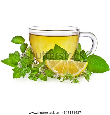 Tea cup with lemon mint herb leaves isolated on a white background - stock photo