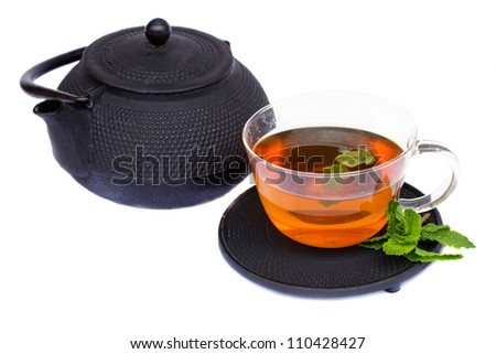 tea cup with mint and teapot isolated on white background - stock photo