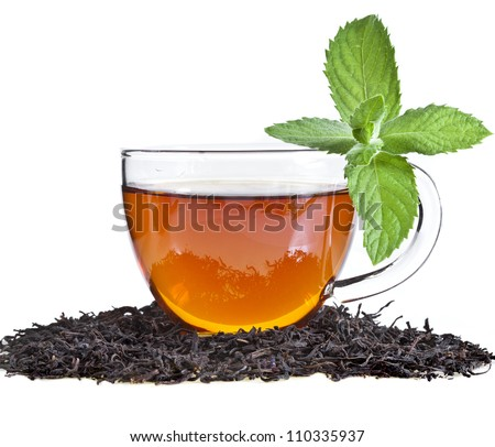 Tea cup with mint leaves on a white background - stock photo
