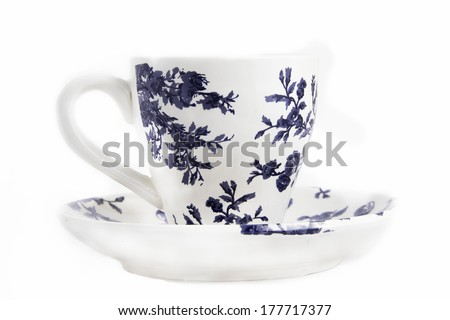 Tea cup with saucer with floral pattern - stock photo