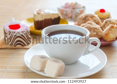 Tea, fresh cherry muffin, colorful delight, eclair and doughnut, various sweet dessert, close up - stock photo
