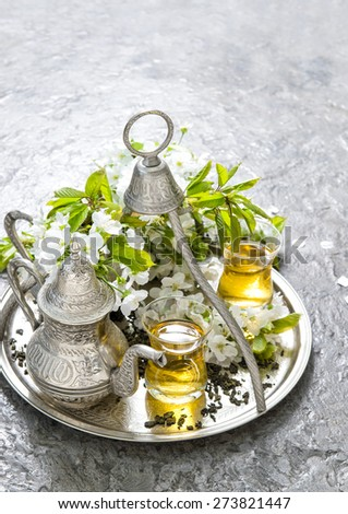 Tea glasses and pot. Oriental holidays decoration. Silver Tableware - stock photo