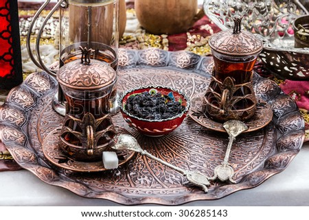 tea glasses Turkish traditional tea table appointments, Turkey. - stock photo