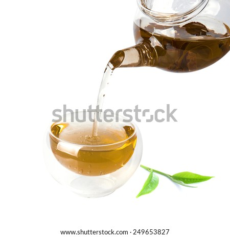 Tea is brewed in a transparent cup on a white background   - stock photo