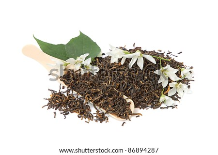Tea leaves with fresh jasmine flowers and spoon on white background - stock photo