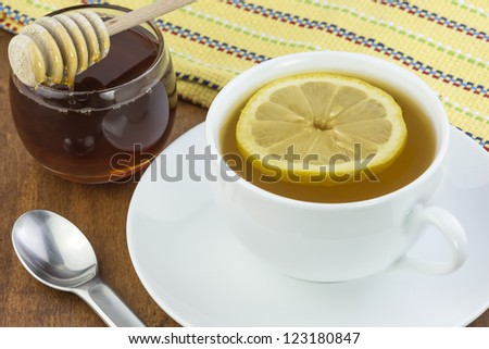 tea lemon and honey to sooth a cold - stock photo
