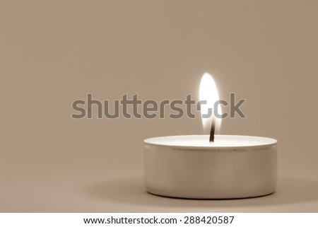 Tea light with copyspace, vintage toned - stock photo