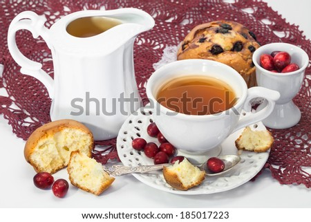 tea, muffins and fresh cranberries for breakfast - stock photo