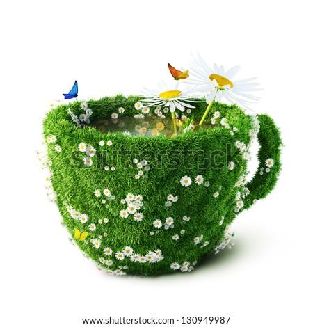 Tea mug from  grass and camomiles. healthy food - stock photo