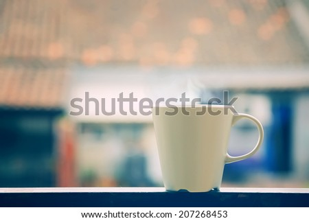 Tea mug, steam and window view - stock photo