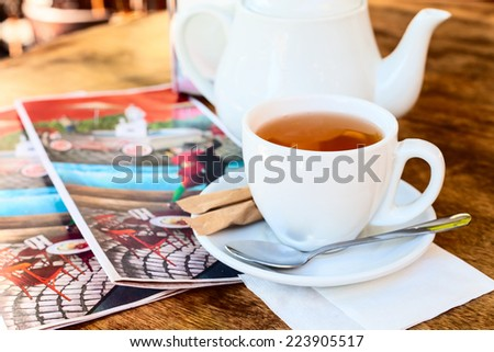 tea on the table. Teapot and cap - stock photo
