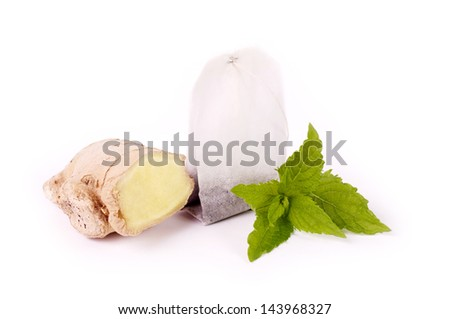 Tea package with ginger and mint - stock photo