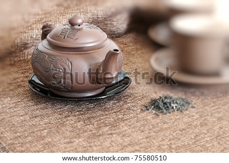 tea pot, cups  and green tea - stock photo