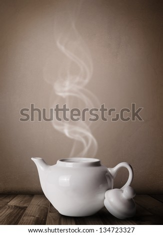 Tea pot with abstract white steam, close up - stock photo