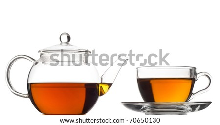 tea pot with tea and cup - stock photo