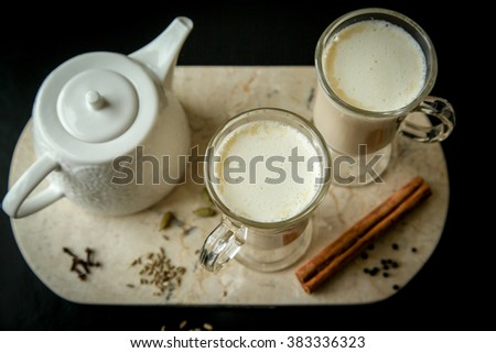 Tea pot with tea begs - stock photo