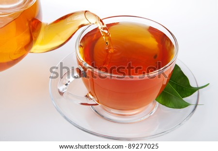 tea pouring into cup - stock photo