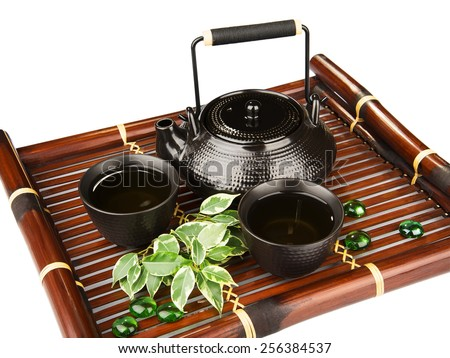 Tea set on a bamboo mat - stock photo